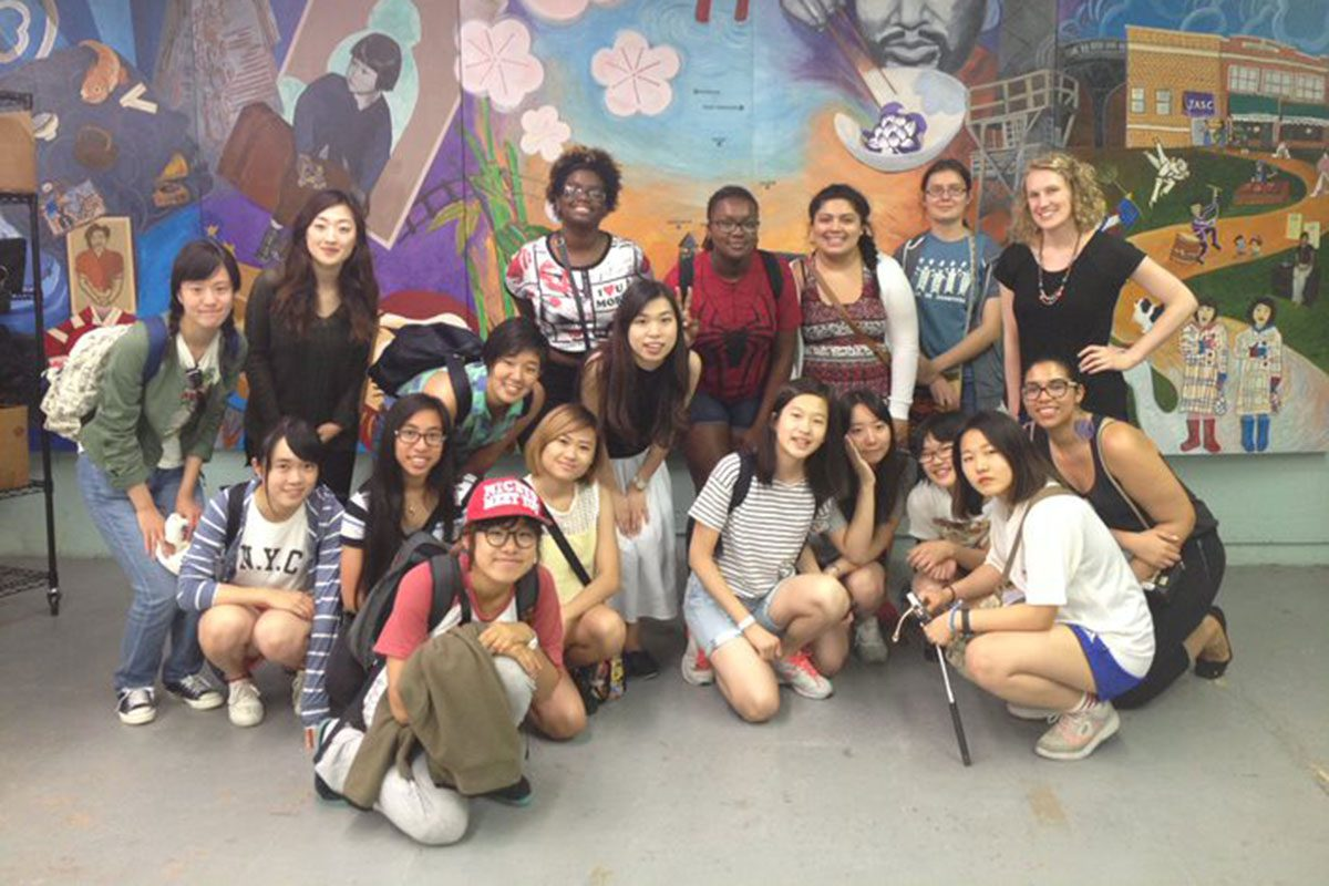 Youth program visits a mural in the city